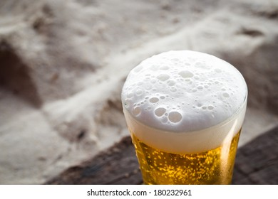 Beer close-up in glass on sand beach
