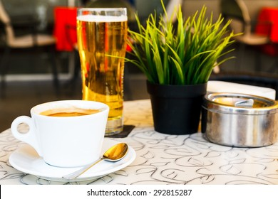 beer and coffee and ashtray on the table