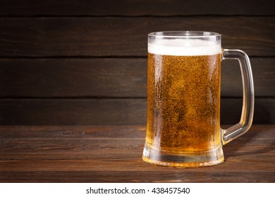 Beer. Cold beer in glass on a dark background.