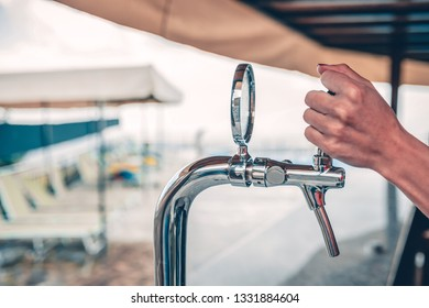 beer faucet in the beach bar.close-up of beer equipment
