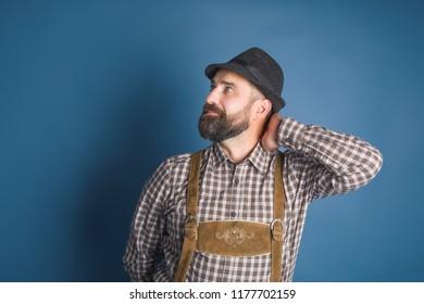 Beer Festival Oktoberfest. Man in traditional bavarian clothes Lederhose
