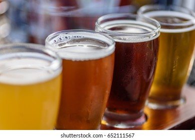 Beer flight on sunny day at outdoor craft brewery - macro with selective focus