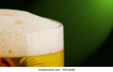 beer with foam in a circle on a dark background