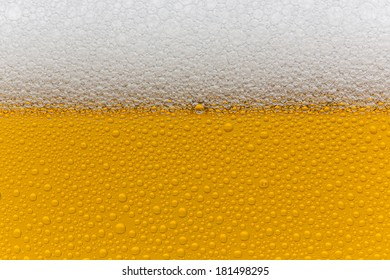 Beer foam with drops of condensation