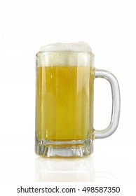 Beer freshly poured into a beer mug.