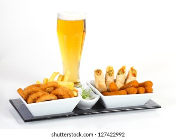 Beer and fried calamari chips and rolled vegetables