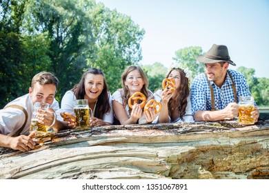 In Beer garden in Bavaria, Germany - friends in Tracht