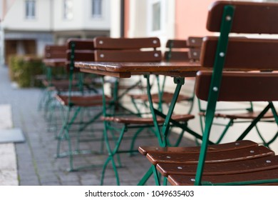beer garden wooden table and chair in a restaurant on a rainy day in september at south germany city stuttgart