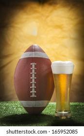 Beer glass and american football ball