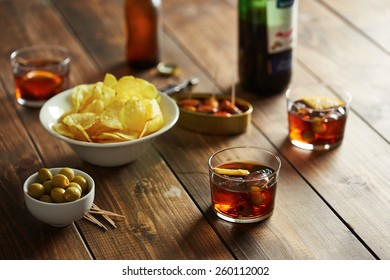 Beer glass with appetizers such as olives, potato chips and mussels