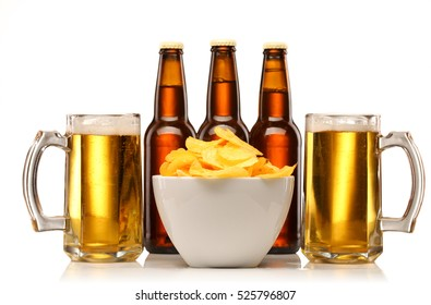 beer glass and bottle with chips isolated on white background