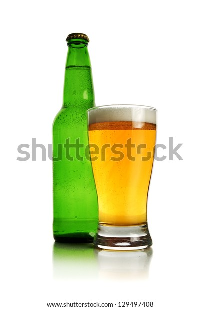 Beer glass and bottle. Green bottle and glass of cold beer over white background.