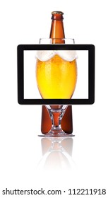 beer glass and bottle on tablet computer screen  isolated on a white background