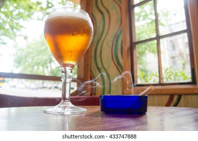 Beer in Glass Cup with cigar
