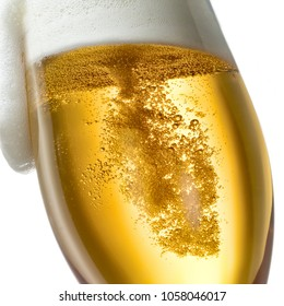 Beer in glass with foam