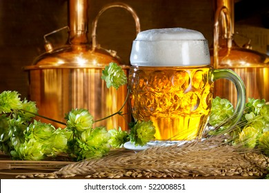 Beer glass with hops and barley in the brewery