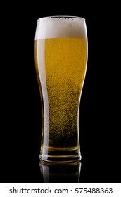 Beer glass isolated over black