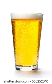 Beer glass with light colored beer and foam on a white background