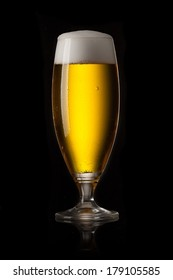 beer glass on a black