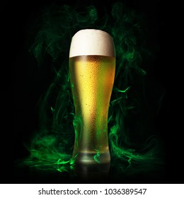 Beer glass on a green smoke. St. Patrick day Theme