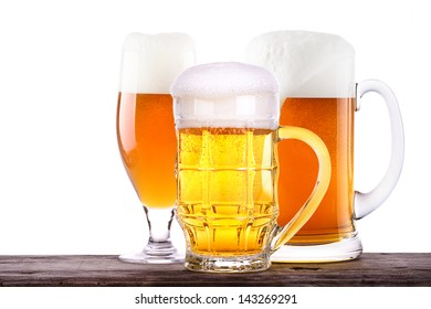 Beer glass on old wooden table background isolated