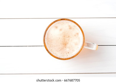 Beer glass on white wooden table. Close up