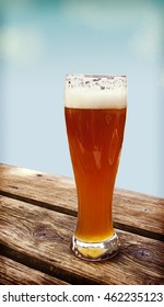 Beer glass on wooden bench