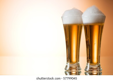Beer glasses against the colorful gradient background