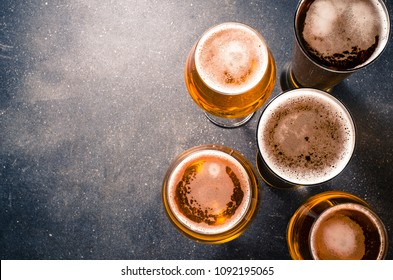 Beer glasses on dark table. Top view