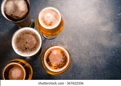 Beer glasses on dark table