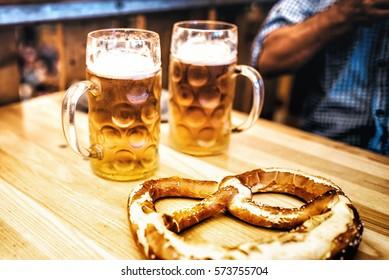 beer glasses and pretzel on Oktoberfest table