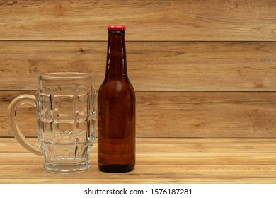 Beer gold bottle with glass for beer