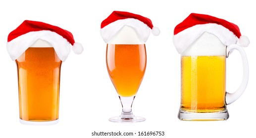 Beer and hat of Santa Claus isolated on white