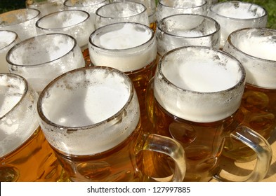 Beer jugs on wooden desk, outdoor