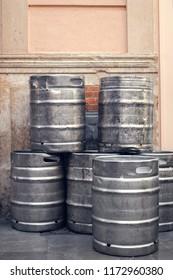 Beer keg barrels stacked outside a building