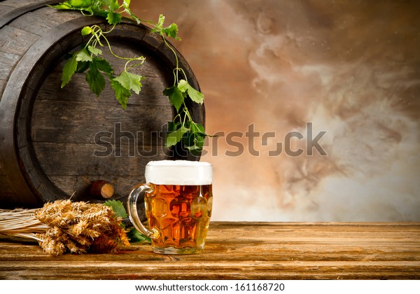 Beer keg with glass of beer and blur background