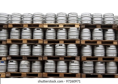 Beer kegs in rows over white background