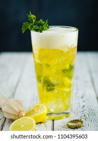 Beer lemonade with mint and slice of lemon in Highball glass