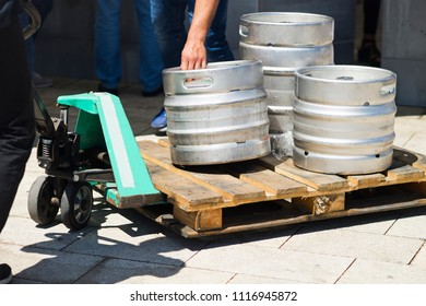 beer metallic kegs in city street for delivery
