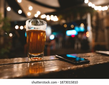 Beer and Mobile Phone in Bar