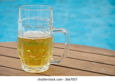 beer mug by the swimming pool