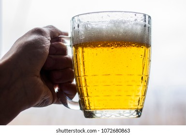 beer mug in hand