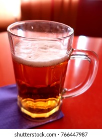 beer in a mug on a table