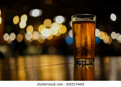 Beer mug on table with bokeh background