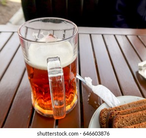 Beer mug on a wooden table