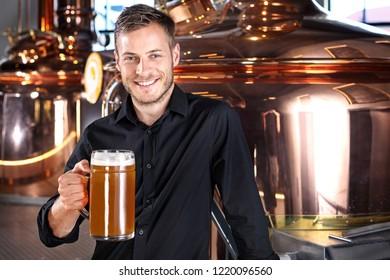Beer mug. Smiling handsome man with a glass of beer