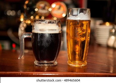 beer mugs , black and light bear on bar counter
