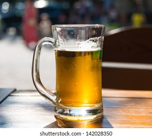 beer mugs close-up on wooden table