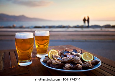 Beer and Mussel at the sunset