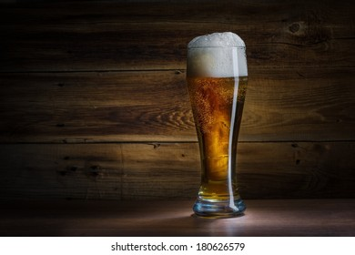 beer on background wooden wall